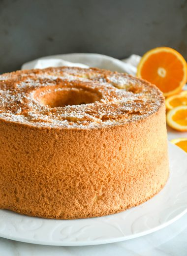 Orange chiffon cake whole, on a serving plate