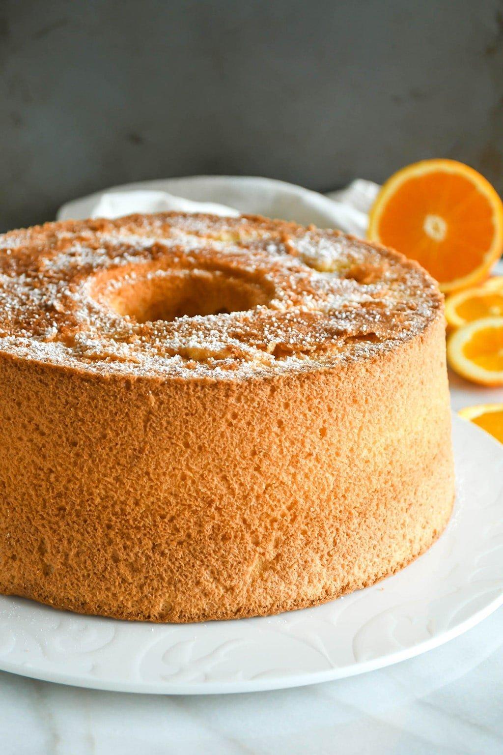 Orange chiffon cake whole, on a serving plate