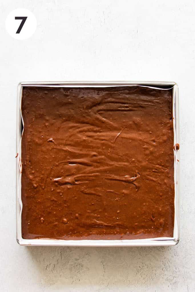 square pan filled with brownie batter