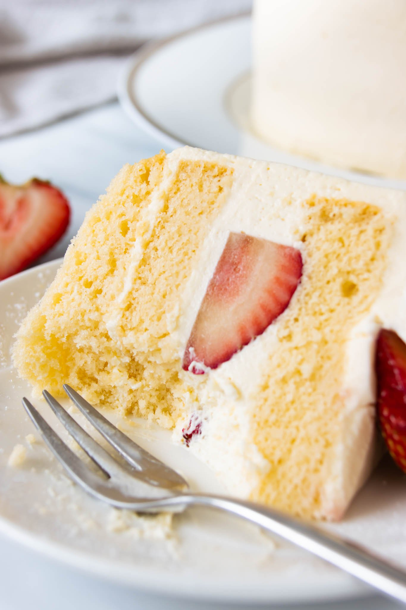A slice of strawberry shortcake with a moist and delicate crumb
