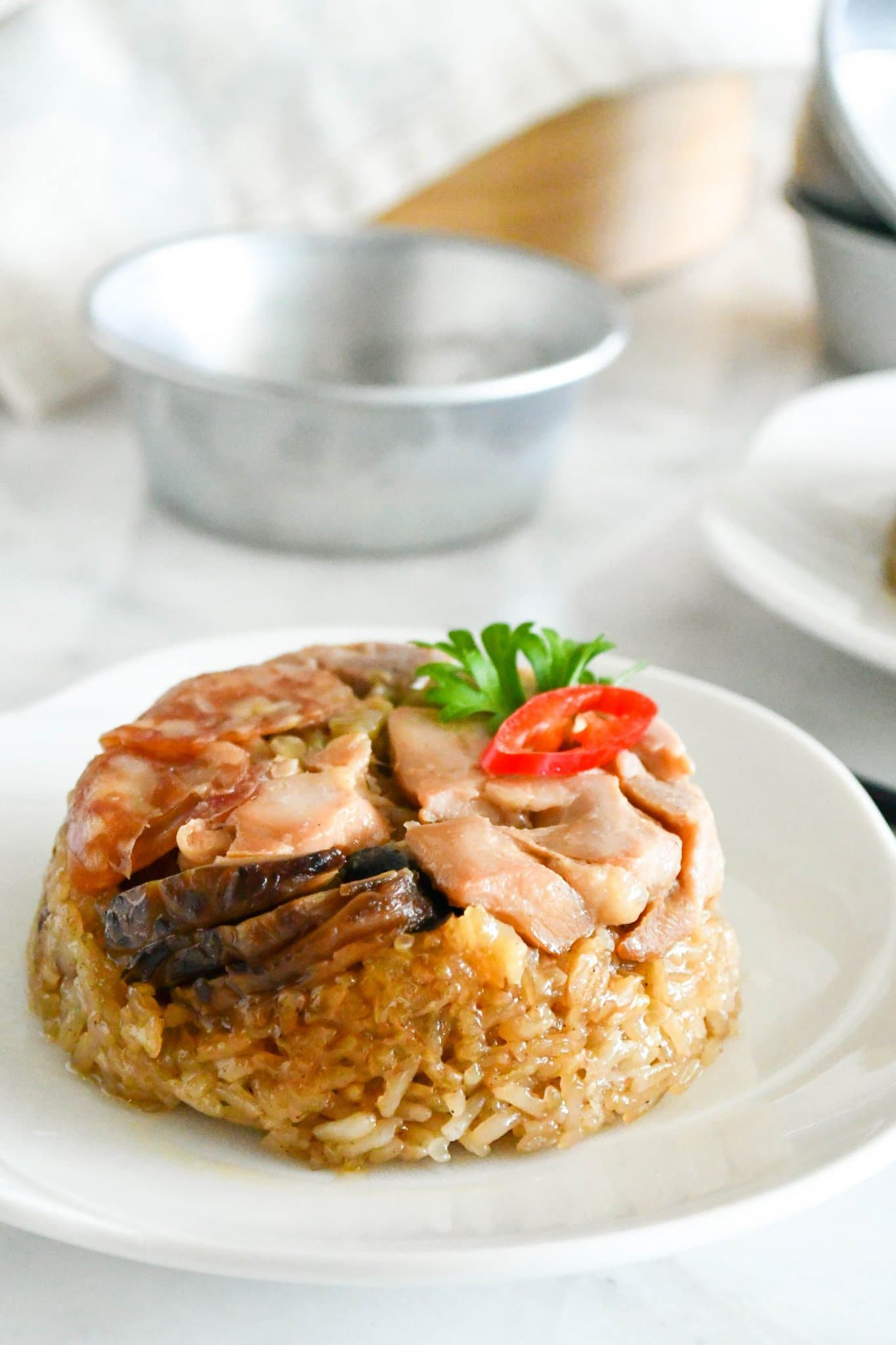 loh ma kai (steamed glutinous rice with chicken) on a plate