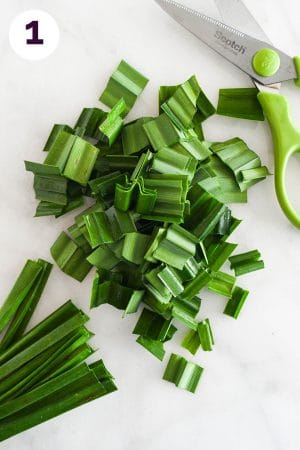 Cutting pandan leaves into short sections