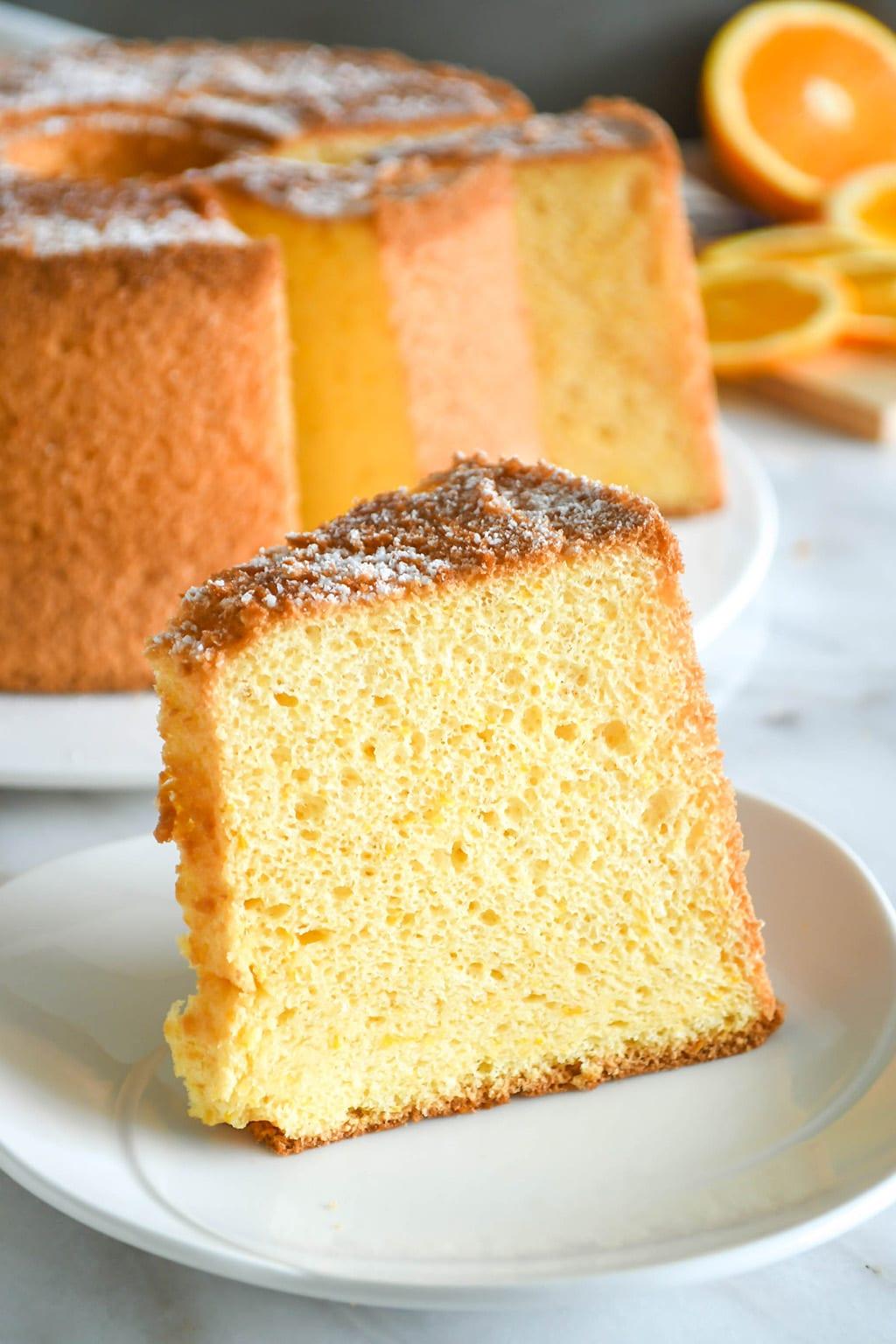 Orange chiffon cake slice, on a serving plate