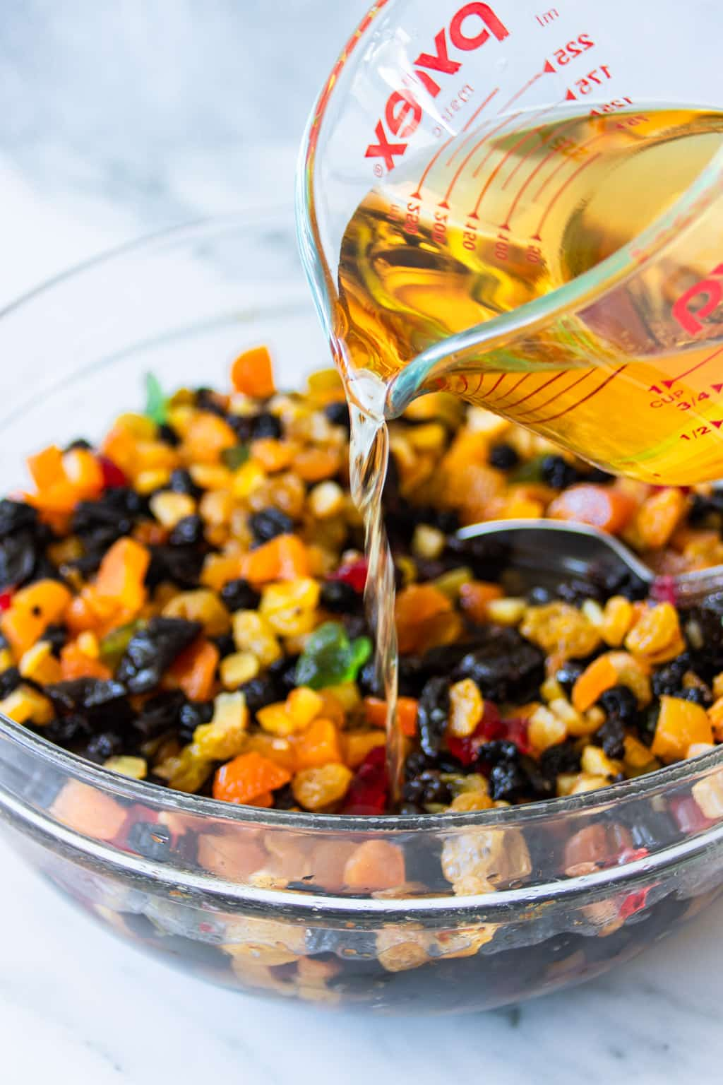 Soaking dried fruit mix in rum for fruit cake