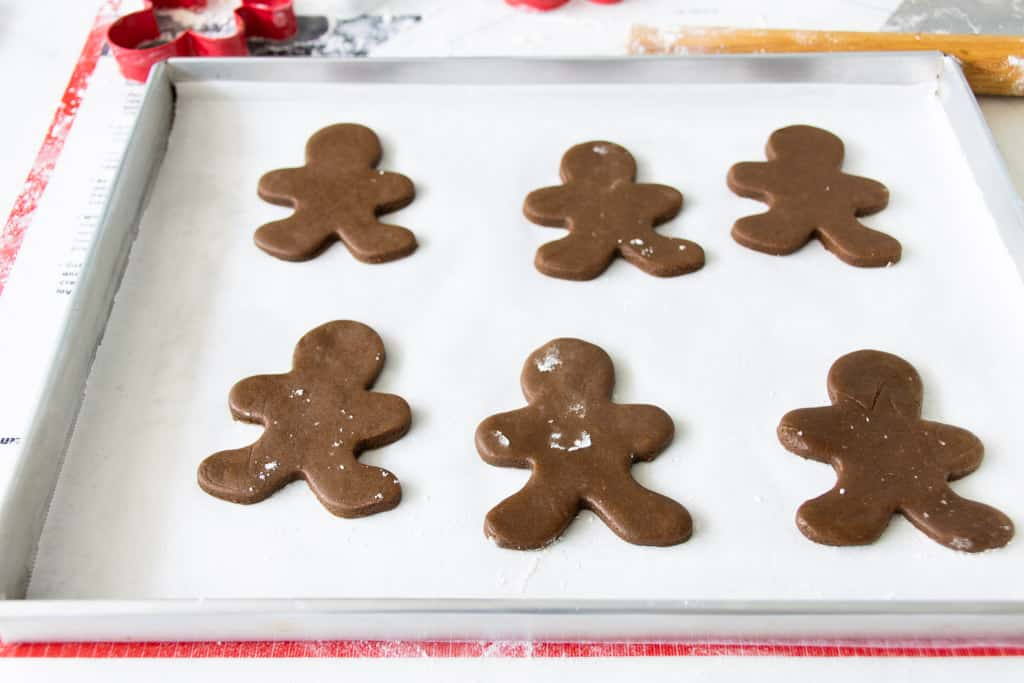 Cut-out gingerbread man cookies on a baking tray