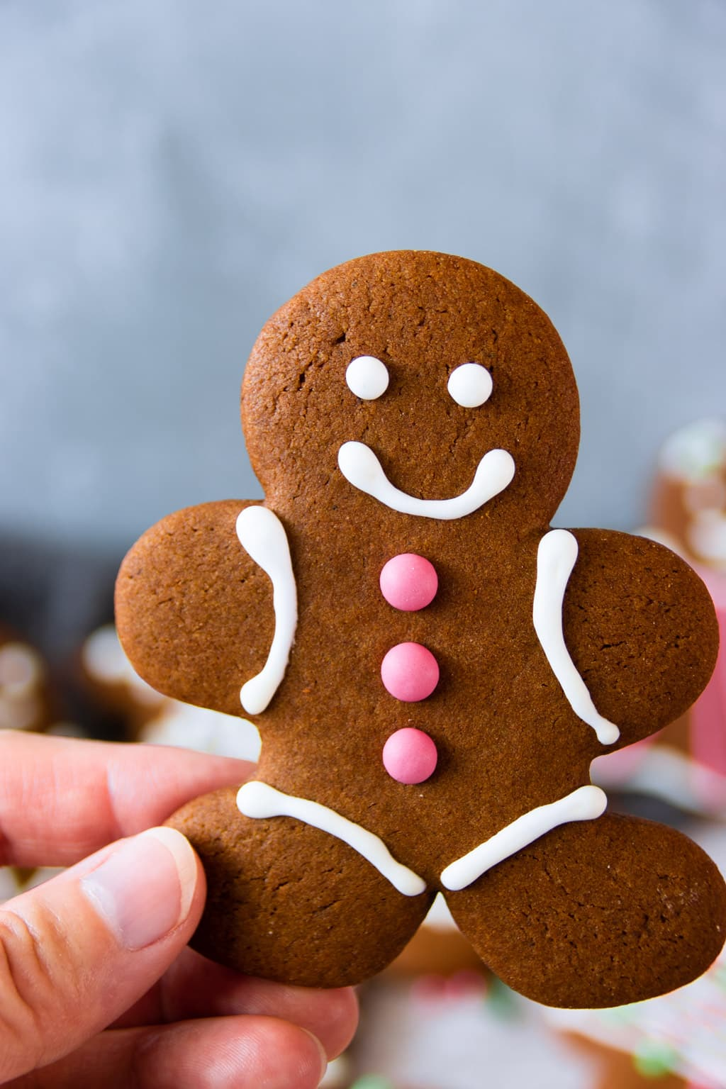 A gingerbread man cookie in focus