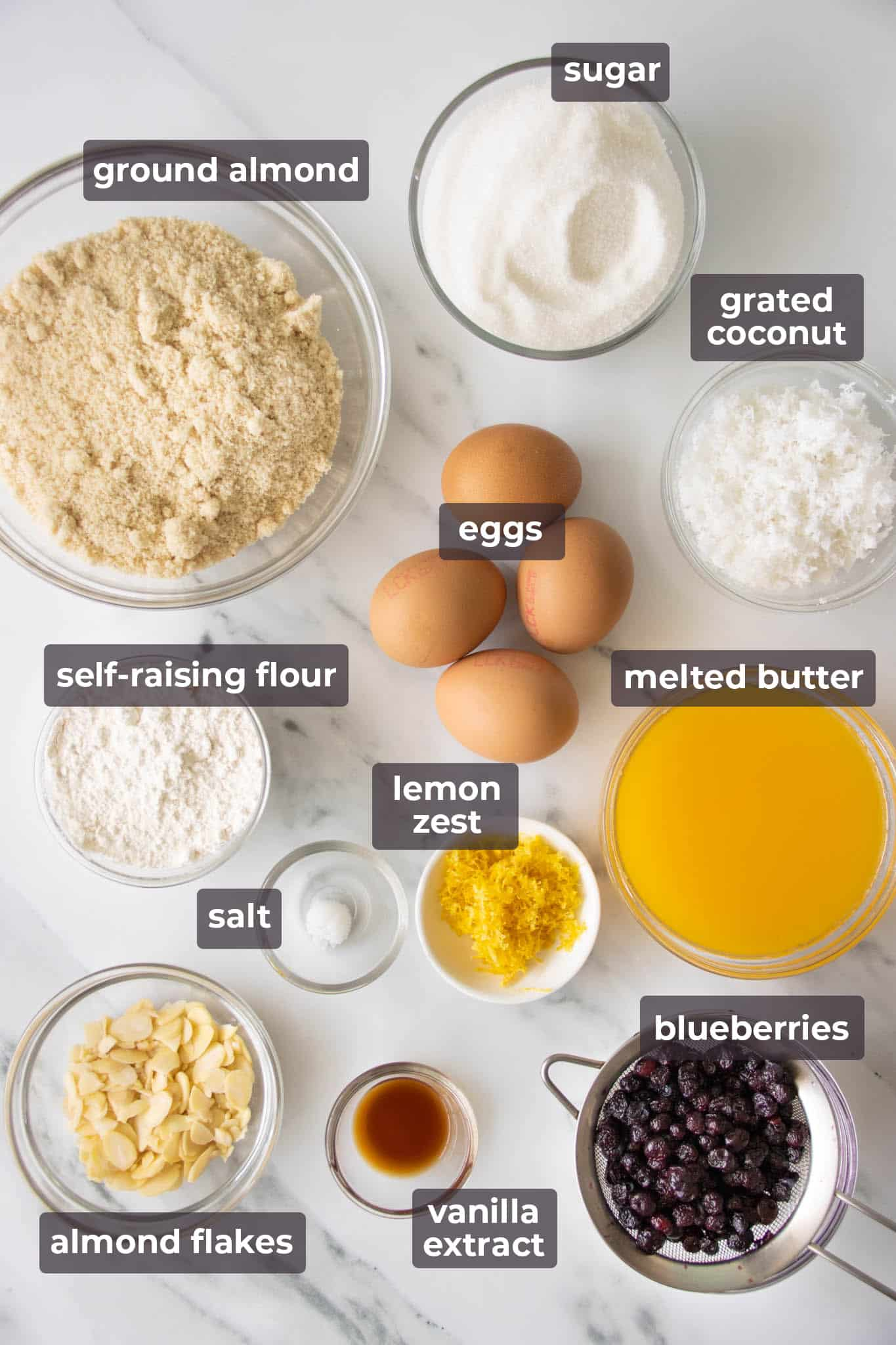 Ingredients for making coconut, almond and blueberry cake