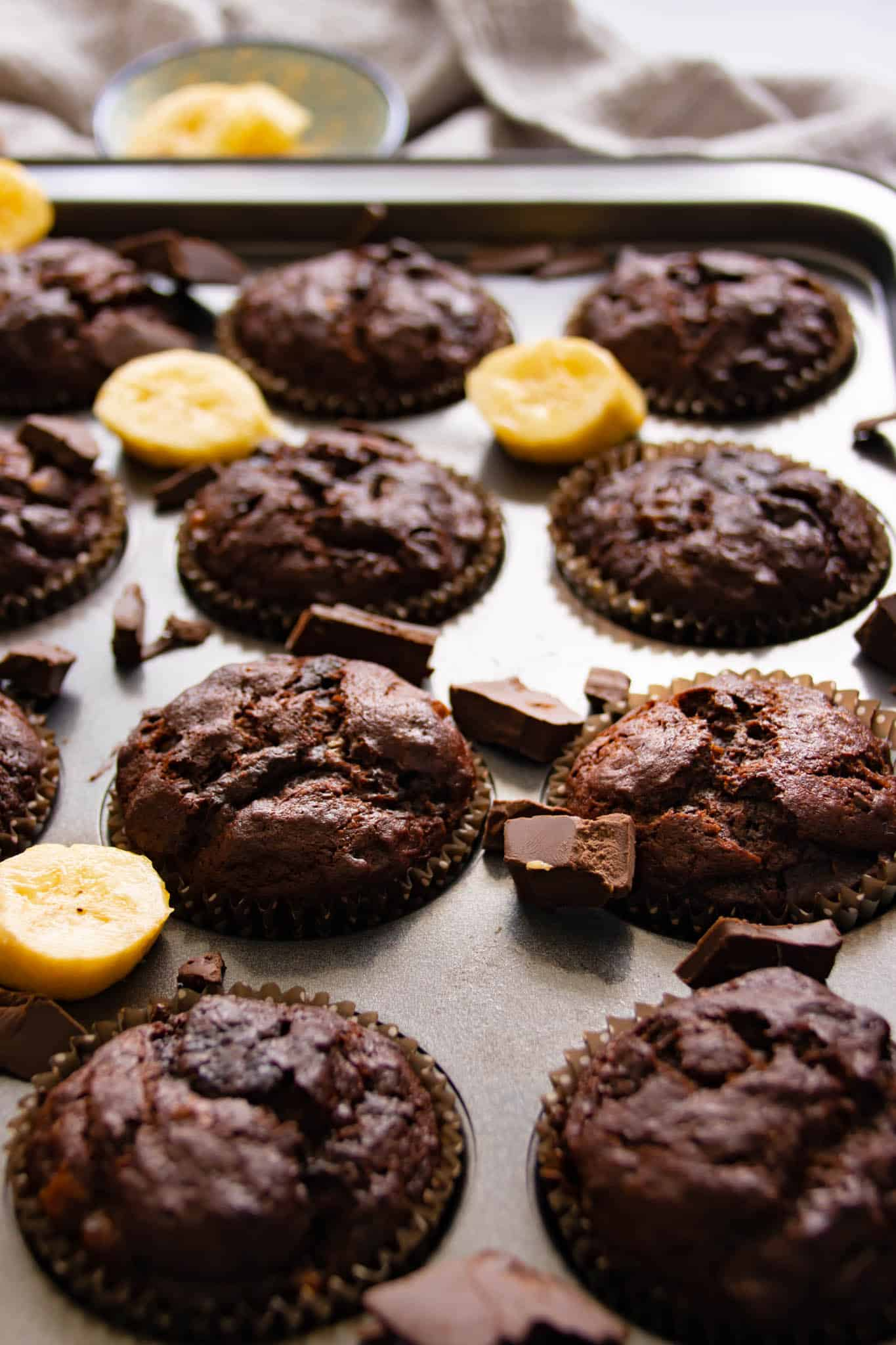 Double chocolate banana muffins, fresh baked in a muffin tray