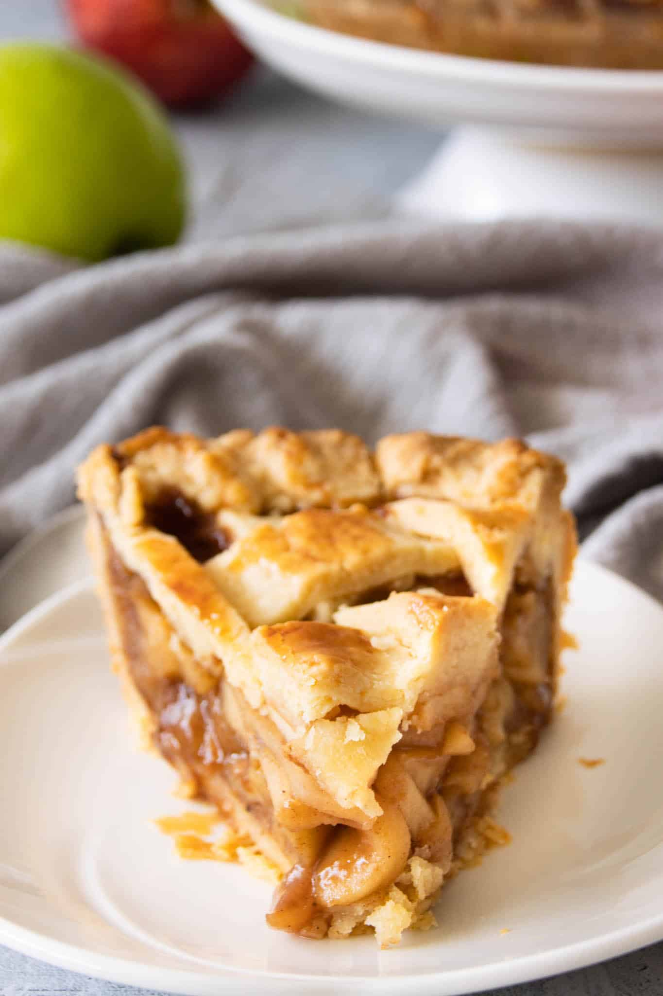 A slice of homemade apple pie with caramelised apple filling