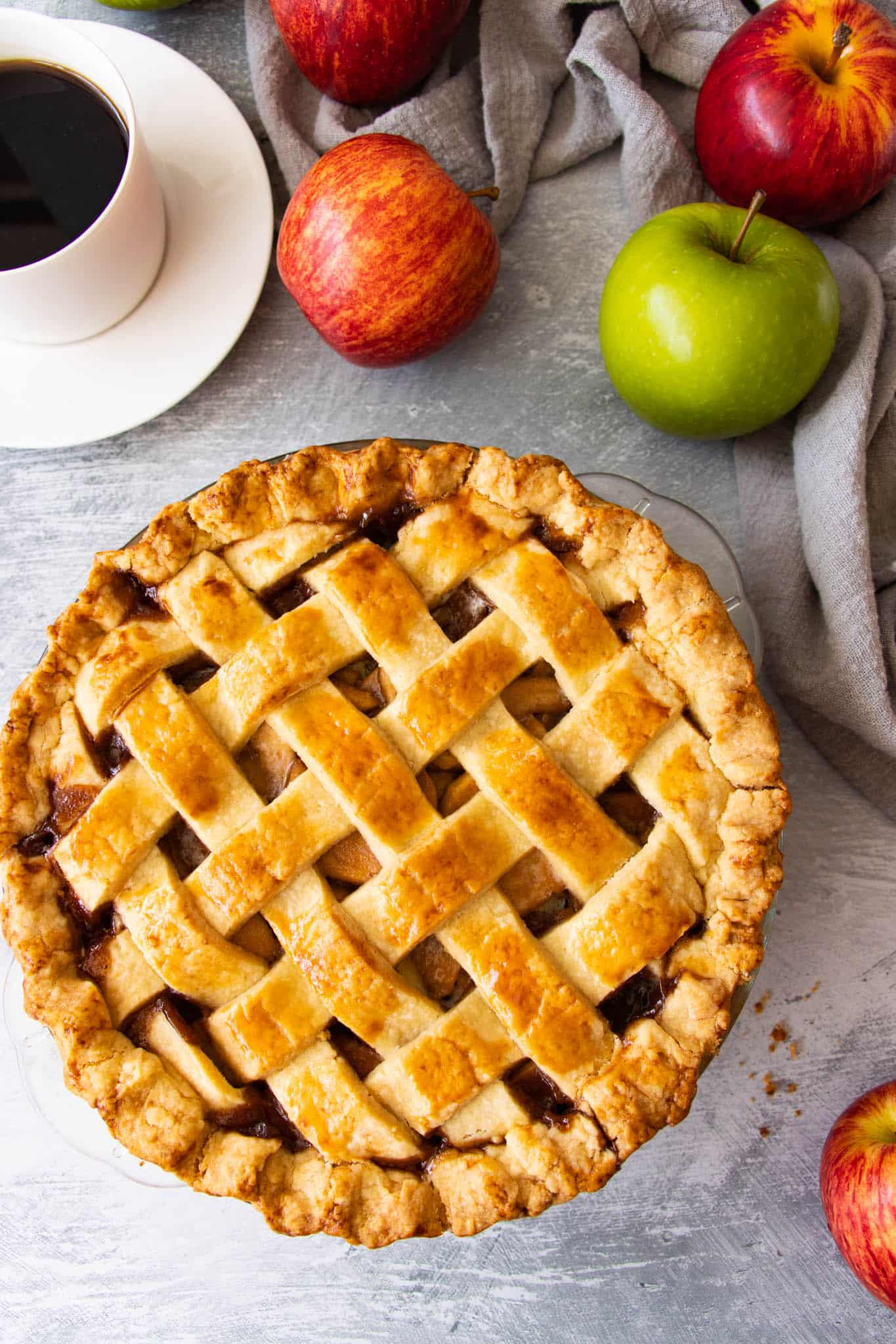 Fresh baked apple pie with a golden brown crust and caramelised apple pie filling
