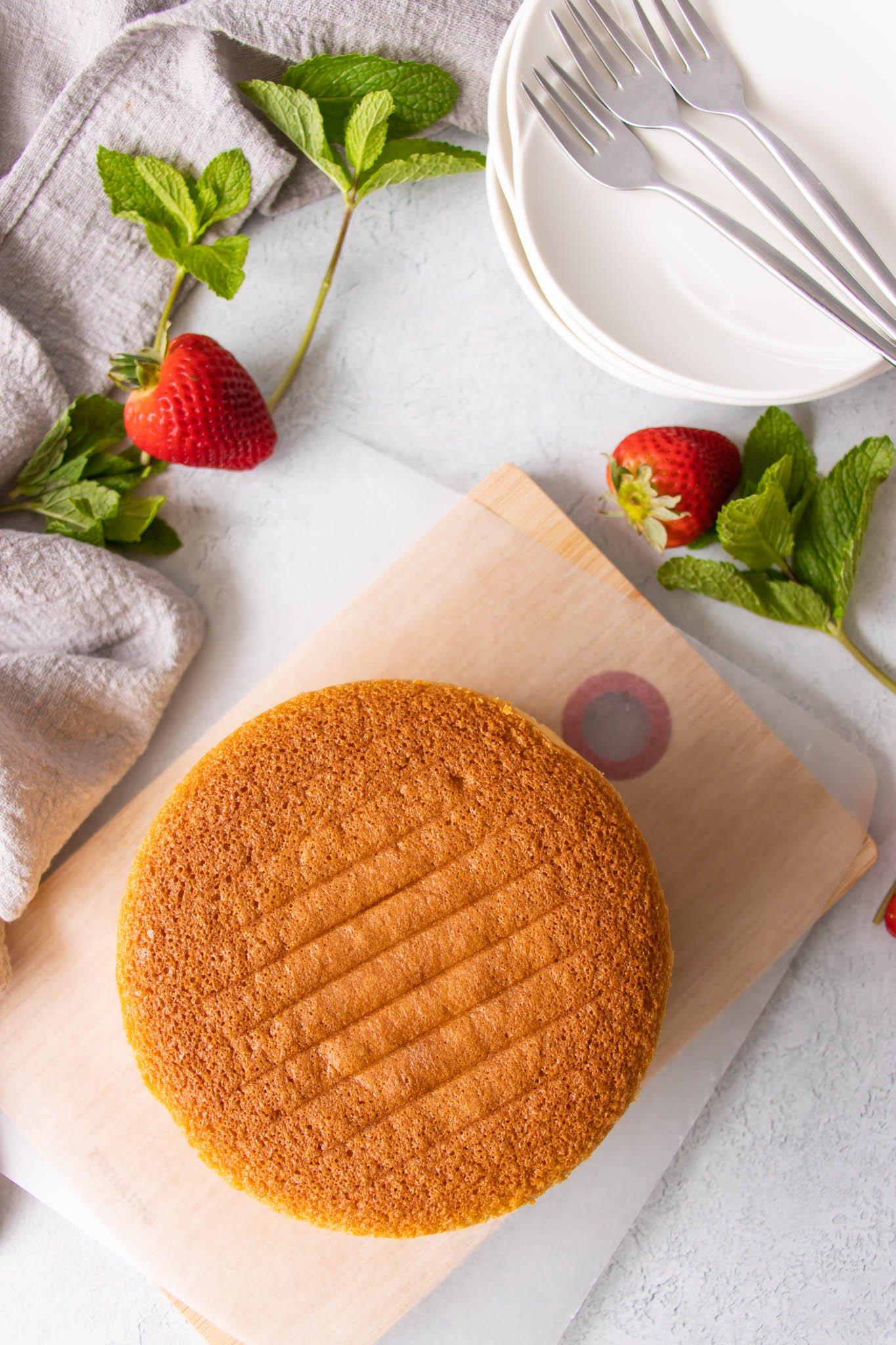 Genoise sponge cake. set on a wooden board