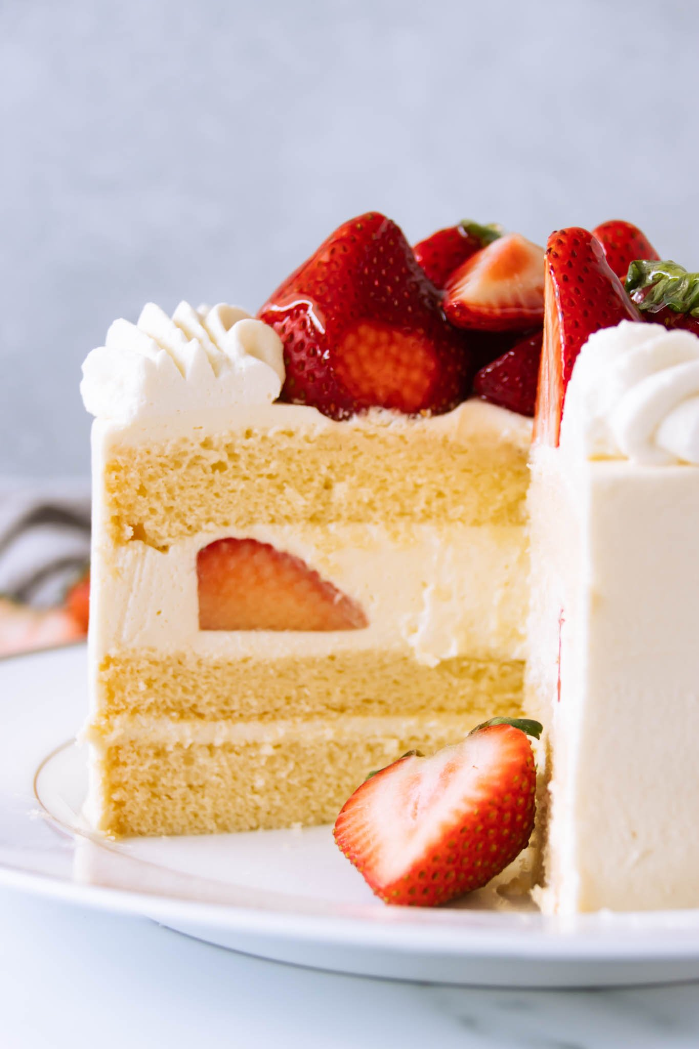 Sponge cake layers filled with whipped cream and fresh strawberries for a Japanese-style strawberry shortcake